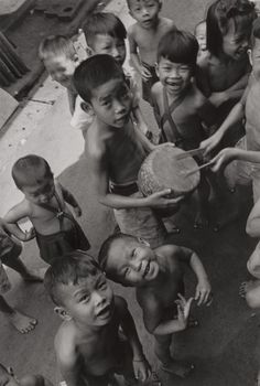 Photographs:Gelatin Silver, Ernst Haas (American/Austrian, 1921-1986). The Children Gay andWell Fed, Siam, 1950. Gelatin silver. 11-3/4 x 8 inches ...