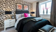 A monochrome bedroom with a touch of bright pink.