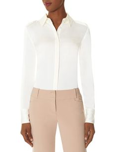 Epaulet Blouse from THELIMITED.com Elegant and confident, The Limited collection inspired by SCANDAL embodies the aesthetic of Olivia Pope for real-life Gladiators and everyday fashionistas. Elevated fabrics and details have a luxurious look and feel for powerfully sophisticated styling! Rich crepe Point collar, concealed placket Epaulet shoulder loops with metal bar accent Full sleeves with 3-button cuffs
