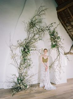 Overgrown beauty See more today on Once Wed. Floral Design and Ivory Lace Wedding Dress, Floral Wedding, Wedding Flowers, Floral Arch, Arte Floral, Ceremony Arch, Wedding Ceremony, Gazebos, Flower Installation