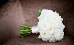 All white bouquet. ELEGANT! white roses, ranunculus, and white peonies.