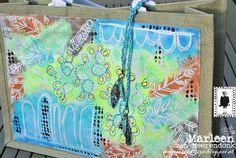 StencilGirl Talk: Stencil a Summer Beach Bag by Marleen van Meerendonk using stencils designed by Rae Missigman (feathers and several flower stencils with masks).