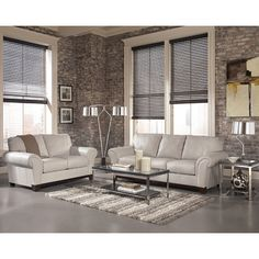 The rich contemporary design of the Deasil Iceberg Living Room Set by Signature Design by Ashley Furniture features a stylishly curved design with warm finished tapered block feet that create a refreshing look that is sure to enhance any living room decor.