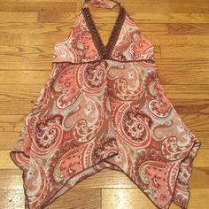 hello aummerBoho Crocheted trim halter. Medium halter in shades of brown, cream, pink, and rust. 100%polyester sheer with lining for the top. Tie back at waist. HeartSoul Tops Tunics