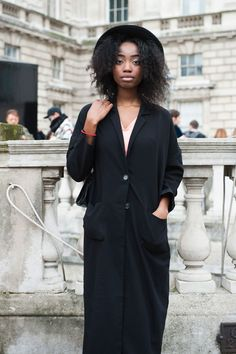 Street Style From London Fashion Week Fall 2015 - black longline drapey shirtdress + brimmed hat | StyleCaster