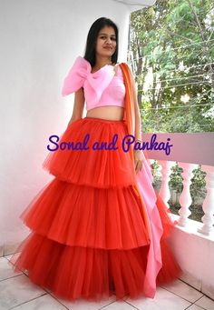 Beautiful red ruffle tulle Lehenga with oversized bow organza top. Choli Designs, Kurti Neck Designs, Blouse Designs, Indian Dresses For Kids, Indian Outfits, Designer Anarkali Dresses, Designer Dresses, Gown Party Wear, Bridal Lehenga Collection