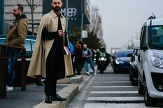 man wearing Burberry trench cape coat