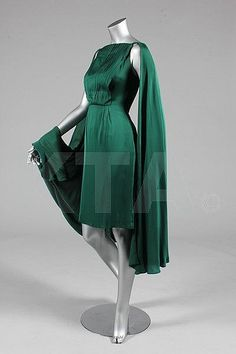 A Biki green satin cocktail dress, circa 1959, Kerry Taylor Auction    ...Kerry Taylor Auctions Catalogue - Antique and Vintage Fashion, Textiles and Accessories | Invaluable