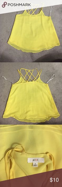 Yellow straps silky tank. Yellow strapped tank with cross cross detailing. Silly material. Small black mark on bottom, can hardly tell. pac sun Tops Blouses