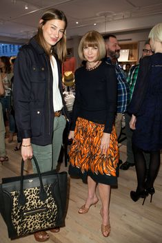 Anna Wintour Knee Length Skirt - Anna dons an orange banana print skirt for the CFDA Fashion Fund Party.