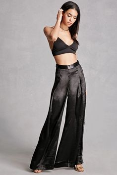 A pair of satin gaucho pants by Endless Rose™ featuring a pleated front, wide-leg fit, and a concealed back zipper.