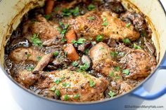 One-pot chicken in wine is cooked over low heat until super tender and flavorful in this recipe. #Coqauvin #frenchcuisine #recipe
