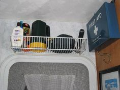 Over the door storage for things you may need to grab before you go out. sunscreen, flashlight, bug spray etc.