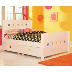 Your little girl can draw the day away with the LittleMissMatched SKETCHoRAMA Panel Bed. It's completely covered in a gloss white dry-erase material which lets her illustrate and erase the surfaces over and over again. Behind the cutout circles in the headboard and optional footboard she can change the panels to reveal solid colors polka dots stripes clear panels or any combination. Place favorite photographs behind the clear panels for a unique