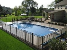 Inground Pool Fence Ideas pool fence ideas made from steel material in black color decorated in modern minimalist pool design Find This Pin And More On Pool Ideas