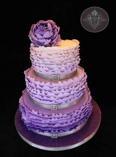 three tiered ruffle ombre pueple peony cake, all gumpaste details except for tthe ribbon and buckle