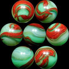 7 views of one GORgeous vintage Akro Agate marble.