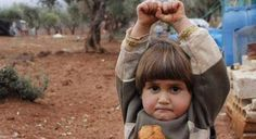 this child from syria thought that the camera was a weapon and lifted his hands up so as not to get shot