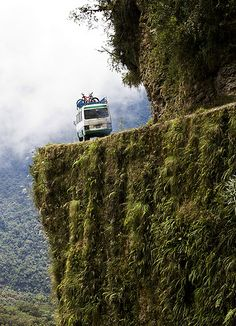 """The World's Most Dangerous Road - photo by Steve Tran (netwalker), via Flickr;  Death Road (North Yungas Road or Coroico Road) is a 38 mile road from La Paz to Coroico, Bolivia. It is legendary for its extreme danger and in 1995 the Inter-American Development Bank christened it as the """"world's most dangerous road."""" One estimate is that 200-300 travelers are killed yearly along the road.  - info from Wikipedia"""