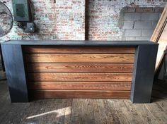 Sitting at 96x42 The steel column and reclaimed wood reception desk certainly has a presence. The sleek design and combination of materials makes for a truly unique piece. Can be made to order to any size.