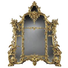 An Antique Giltwood Mirror of Substantial size in the Rococo Chippendale Manner   From a unique collection of antique and modern wall mirrors at http://www.1stdibs.com/furniture/mirrors/wall-mirrors/
