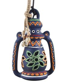 This beautiful piece of earthen lantern painted in red and other bright colors amicably suits to the balconies and gardens to add beauty to the surroundings. It comes with an electric bulb for lighting purpose