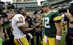 Robert Griffin III and Aaron Rodgers greet each other after the Packers' 38-20 victory.