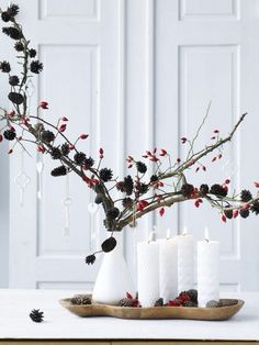 To give your house a luminous glow, we've compiled a list of beautiful Christmas candle decoration ideas for you. Christmas Candle Decorations, Scandinavian Christmas Decorations, Advent Candles, Nordic Christmas, Christmas Mood, Noel Christmas, Christmas Vignette, Diy Candles, Holiday Ornaments