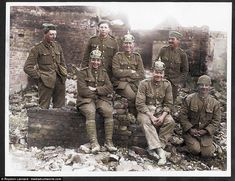 A group of happy Tommies, some wearing German helmets taken from the enemy, are seen in At...