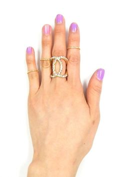 For more details visit our website :- http://www.choosyshopper.com/shop/women/statement-jewelry/statement-rings/gold-multi-ring-set-with-rhinestone-design/