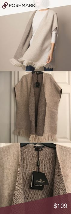 MASSIMO DUTTI WOOL BLEND BI-COLOUR FRINGED CAPE Sooo SOFT and such a wonderful texture..AND So Much More Beautiful in Person!! My camera does not do it justice. Beautiful Flecked cape in two-tone design.. Wool blend.. gorgeous fringe.. straight cut design. Brand new with tags. Massimo Dutti Jackets & Coats Capes