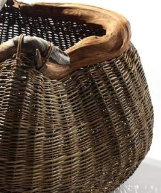 Basket by Joe Hogan, Ireland: Swirling Root. Bog Pine, Willow rods.