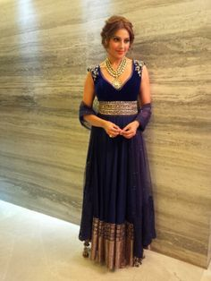 She wearing floor-length anarkali suit and beautiful necklace
