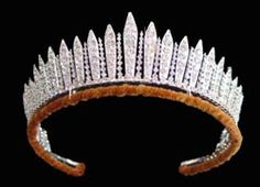 "King George III Fringe Tiara. Also known as the Russian Fringe Tiara. Includes 60 diamonds that were formerly owned by George III. Queen Victoria wore it as a tiara on an official visit to the opera in 1839. Queen Mary inherited the tiara when she became Queen Consort in 1910, and she gave it to her daughter-in-law Queen Elizabeth in 1937 on Elizabeth's marriage to King George VI. Elizabeth, The Queen Mother, loaned it to her daughter Princess Elizabeth as ""something borrowed"" for her…"