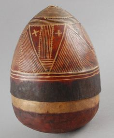 Egg-shaped skin (tandu) container (a) and lid (b). Decorated with geometric patterns in dark red pigment on lid and solid red on lower part of base. Traces of earth? and fur inside container. 1970-1971 (?), made in Nigeria