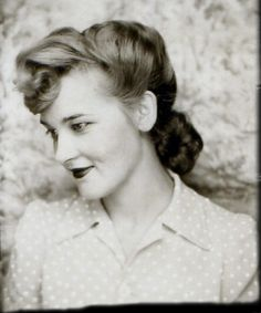 ** Vintage Photo Booth Picture ** Beautiful young woman during the 1940s.