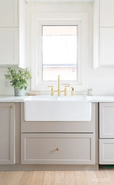 See how a designer transformed an outdated kitchen using IKEA cabinets customized by Semihandmade. See how a designer transformed an outdated kitchen using IKEA cabinets customized by Semihandmade. Farmhouse Style Kitchen, Modern Farmhouse Kitchens, Kitchen Modern, Modern Ikea Kitchens, Ikea Farmhouse Sink, Light Grey Kitchens, Minimalistic Kitchen, Small Kitchens, Updated Kitchen