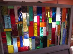 REPURPOSED window kept out of the landfill. Handmade stained glass riot of color panel