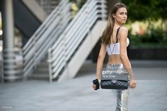 Model Fernanda Liz seen wearing Pants from Isabel Marant, top from Osklen, boots Barbara Bui and bag from Chanel in the streets of Manhattan during