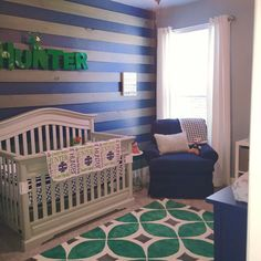 Green and Blue Nursery with Wood Accent Wall - Project Nursery