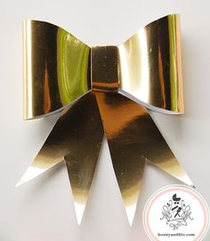 DIY-Paper-Bow-Garland-Gold-Bow-@-Honey-and-Fitz