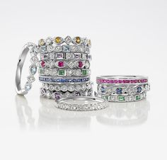 Mothers ring bands with children's birth stones - I like the light blue with square design.