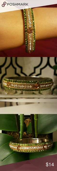 """Crystal Rhinestone Gold beaded Bracelet Bangle Crystal Rhinestone 8 inch beaded Bracelet Bangle  Purchased in a small boutique.   Green, Gold, diamond, Amber/yellow """"Swarovski like"""" crystals.   Not sure if this is Swarovski or not but it shines brightly like Swarovski.   Very pretty. Jewelry Bracelets"""
