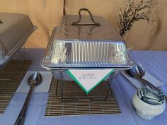 Disposable Chafer pans dish  Lid Idea. Take the water pan lid, turn upside down and hot glue a homemade handle. Made out of Popsicle stick and braided twine. Make a paper pennant and attached to handles of chafer rack.