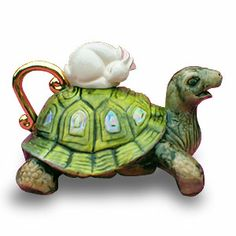 Tortoise / Hare  Teapot by Cornish sculptor Andy Titcomb,  which is a limited edition of 550.  post from  teapots teapots teapots...all the latest teapot news and pictures updated virtually every day.