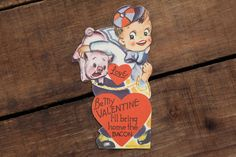 This is a 1950s Vintage Valentine in good used condition. It has adorable little boy and pig on the front. The text on the front says that
