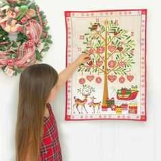 This nostalgic advent calendar will cheer up the most dismal of December days. When you buy this advent calendar you'll be creating a new family tradition, full of the magic and joy of Christmas. Let your imagination run wild and fill the 24 generously sized pockets with sweets, chocolates, or tiny gifts.