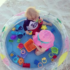 BEACH HACK:  take a cheap small inflatable kids pool to the beach, and your baby will be safe and entertained the easy way!!  Add water or not - customize to your needs.
