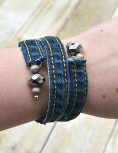 Make something old into something new with this upcycled Denim DIY Wrap Bracelet tutorial. Learn how to make a bracelet out of the seams of an old pair of jeans and rock your own memory wire wrap bracelet!