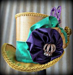 Mardi Gras Mini Top Hat, Facinator, Party Hat, Tiny Top Hat, Tea Party Hat, Mad Hatter Hat, Gold, Purple, Green. $32.00, via Etsy.
